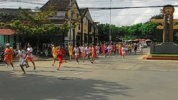 Participating in a running race